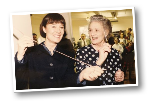 Jean Bedells FRAD ex Principal Sadlers Wells Ballet with Alison cutting the ballet shoe ribbons to open the studio in 1995.